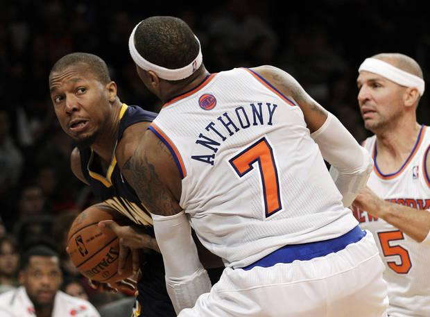 Indiana Pacers forward David West, left, looks to pass around the defense of New York Knicks forward Carmelo Anthony (7) in the first half of their NBA basketball game at Madison Square Garden in New York, Sunday, Nov. 18, 2012. (AP Photo/Kathy Willens)