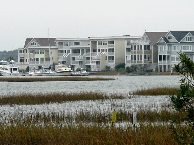 A development along the Intracoastal Waterway in Mount Pleasant, S.C., is seen in this photograph taken on Wednesday, Nov. 14, 2012. Scientists at Clemson University and Georgia Tech have proposed it could be possible to raise the coastline during an era of sea level rise by injecting sediment-laden slurry into fractures beneath the earth's surface. (AP Photo/Bruce Smith).