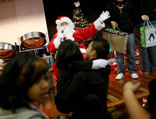 Santa Claus waves to kindergarten students while high school students pass out gifts during the annual Christmas Party and gift exchange at Santa Fe South High School in OKlahoma City on Friday, Dec. 3, 2010. Photo by John Clanton, The Oklahoman