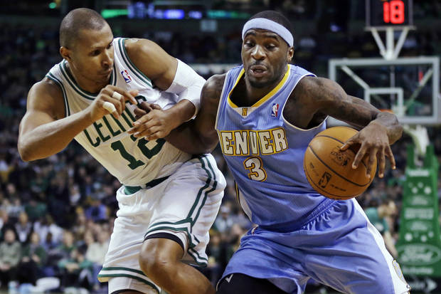 Denver Nuggets point guard Ty Lawson (3) drives against Boston Celtics guard Leandro Barbosa (12) during the fourth quarter of an NBA basketball game in Boston, Sunday, Feb. 10, 2013. The Celtics won 118-114 in triple-overtime. (AP Photo/Elise Amendola)