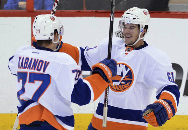 New York Islanders' Riley Wetmore celebrates a first-period goal against the Ottawa Senators with Kirill Kabanov during a preseason NHL hockey game in Ottawa, Ontario, on Sunday, Sept. 29, 2013. (AP Photo/The Canadian Press, Sean Kilpatrick)