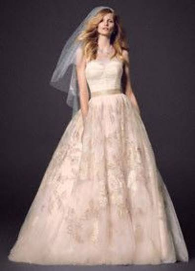Oleg Cassini rose  strapless bridal gown with applique available at David's Bridal.