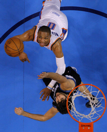 Oklahoma City's Russell Westbrook (0) puts up a shot in front of Minnesota's Ricky Rubio (9) during an NBA basketball game between the Oklahoma City Thunder and the Minnesota Timberwolves at Chesapeake Energy Arena in Oklahoma City, Wednesday, Jan. 9, 2013.  Oklahoma City won 106-84. Photo by Bryan Terry, The Oklahoman