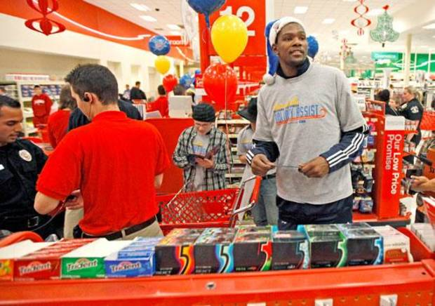 Oklahoma City Thunder player Kevin Durants helps families check out of a target during a shopping spree with the Sunbeam Family Services Grandparents Raising Grandkids program and the Thunder in Oklahoma City, Thursday, December 16, 2010.  Photo by Bryan Terry, The Oklahoman