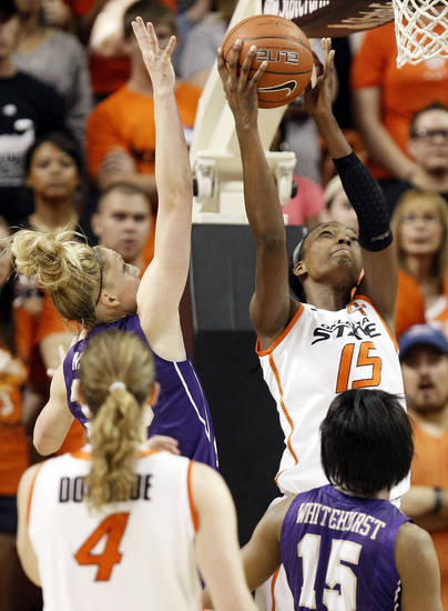OSU's Toni Young (15) takes a shot against James Madison's Nikki Newman (30) during the Women's NIT championship college basketball game between Oklahoma State University and James Madison at Gallagher-Iba Arena in Stillwater, Okla., Saturday, March 31, 2012. Photo by Nate Billings, The Oklahoman