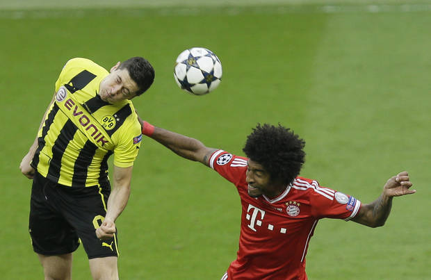 Dortmund's Robert Lewandowski of Poland, left, and Bayern's Dante of Brazil go for a header during the Champions League Final soccer match between  Borussia Dortmund and Bayern Munich at Wembley Stadium in London, Saturday May 25, 2013. (AP Photo/Alastair Grant)