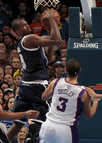 Oklahoma City Thunder's Serge Ibaka (9) rebounds over Phoenix Suns' Jared Dudley (3) as the Oklahoma City Thunder play the Phoenix Suns in NBA basketball at the Chesapeake Energy Arena in Oklahoma City, on Monday, Dec. 31, 2012.  Photo by Steve Sisney, The Oklahoman