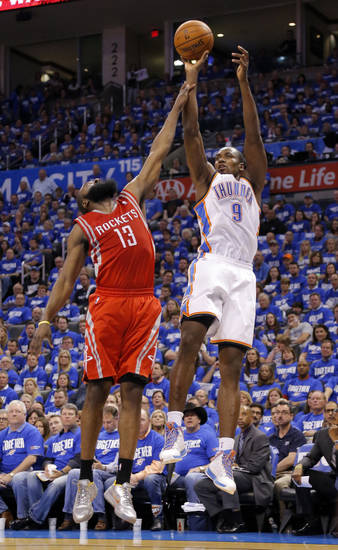 Oklahoma City's Serge Ibaka (9) is fouled by Houston's James Harden (13) during Game 1 in the first round of the NBA playoffs between the Oklahoma City Thunder and the Houston Rockets at Chesapeake Energy Arena in Oklahoma City, Sunday, April 21, 2013. Photo by Sarah Phipps, The Oklahoman