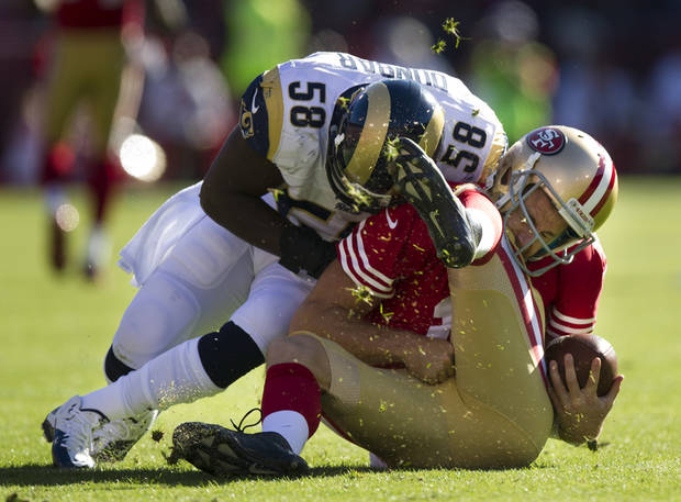 San Francisco 49ers quarterback Alex Smith (11) is tackled by St. Louis Rams linebacker Jo-Lonn Dunbar (58) on a four-yard gain during the first quarter of an NFL football game, Sunday, Nov. 11, 2012, in San Francisco. Smith had a concussion from the play. (AP Photo/The Sacramento Bee, Paul Kitagaki Jr.) MAGS OUT; LOCAL TV OUT (KCRA3, KXTV10, KOVR13, KUVS19, KMAZ31, KTXL40); MANDATORY CREDIT.
