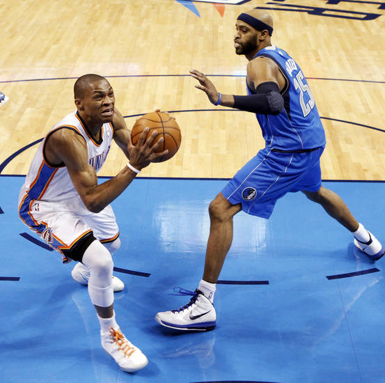 Oklahoma City's Russell Westbrook (0) moves to the hoop past Dallas' Vince Carter (25) during game one of the first round in the NBA playoffs between the Oklahoma City Thunder and the Dallas Mavericks at Chesapeake Energy Arena in Oklahoma City, Saturday, April 28, 2012. Oklahoma City won, 99-98. Photo by Nate Billings, The Oklahoman