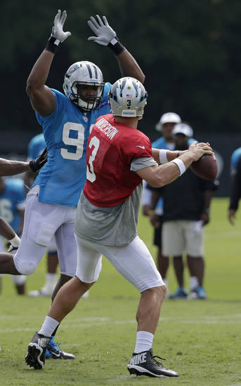 Frank Alexander was a fourth-round pick by the Carolina Panthers in this past year's NFL Draft. Here, the former Sooner is pressuring Panthers QB Derek Anderson. (AP Photo/Chuck Burton)