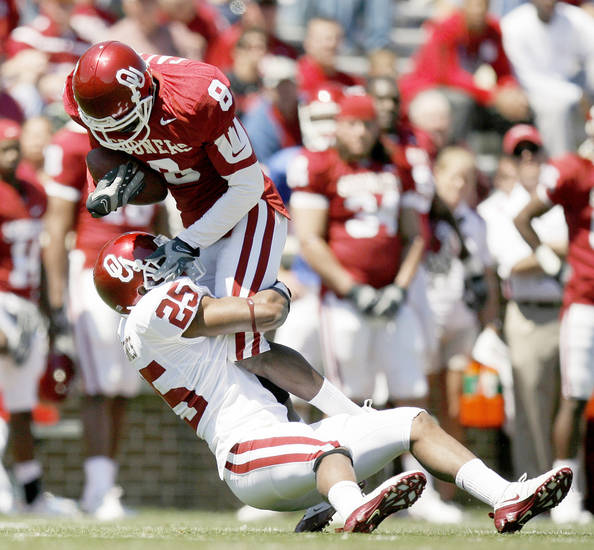 OU senior safety Emmanuel Jones (25) brings down Brandon Caleb during the Red-White Game on April 11. Jones could emerge as an impact player this year. Photo by Bryan Terry, The Oklahoman