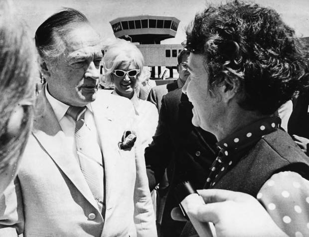 VISIT: Comedian Bob Hope visits with Oklahoma City mayor Patience Latting (right) upon Hope's arrival at Will Rogers World Airport. Hope was in town for the dedication of the Bob Hope Pavillion at Lake Hefner's Stars and Stripes Park, as well as to make an appearance at the Stars and Stripes Show. Staff photo by Jim Argo taken 7/2/71.