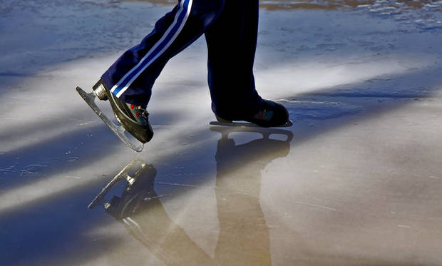 A skater takes to the ice at the Edmond outdoor ice skating rink on Sunday, Dec. 2, 2012, in Edmond, Okla.   Photo by Chris Landsberger, The Oklahoman