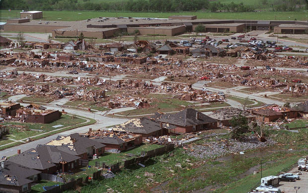 MAY 3, 1999 TORNADO: Tornado damage, aerial view: One of the hardest hit neighborhoods leveled in NW Moore. Westmoore HS is in the background.