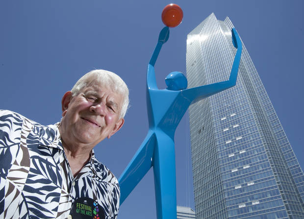 Sculptor Jim Stewart with Stewart Designs stands next to his sculpture &quot;Slam Dunk&quot; at the Festival of the Arts on Friday, April 27, 2012, in Oklahoma City, Okla.  Photo by Steve Sisney, The Oklahoman