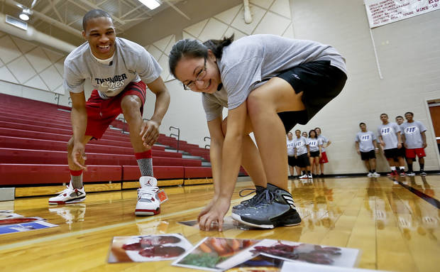 Russell Westbrook races against DeShea Wahpepah in a nutrition trivia contest during a visit by the Oklahoma City Thunder to students at U.S. Grant High School to promote physical fitness on Monday, Jan. 28, 2013, in Oklahoma City, Okla.  Photo by Chris Landsberger, The Oklahoman