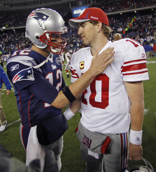 Tom Brady, right, and Eli Manning will face off in the Super Bowl on Sunday night. AP PHOTO