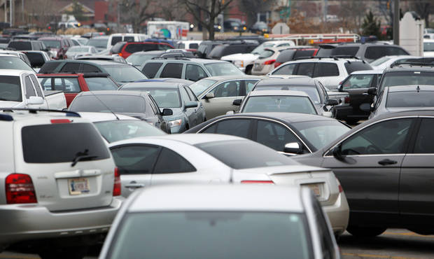 HOLIDAY SHOPPERS: Cars fill the parking lot during Christmas shopping at Penn Square Mall in Oklahoma City, Thursday, Dec. 22, 2011. Photo by Nate Billings, The Oklahoman