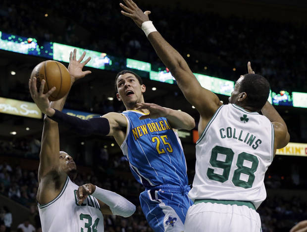 New Orleans Hornets shooting guard Austin Rivers (25) drives to the hoop between Boston Celtics small forward Paul Pierce (34) and center Jason Collins (98) during the second quarter of an NBA basketball game in Boston, Wednesday, Jan. 16, 2013. (AP Photo/Elise Amendola)