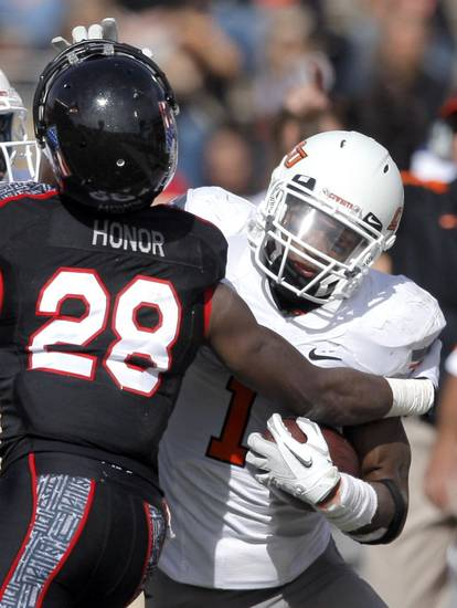 Oklahoma State's Joseph Randle (1) tries to get by Texas Tech's Happiness Osunde (28) during a college football game between Texas Tech University (TTU) and Oklahoma State University (OSU) at Jones AT&T Stadium in Lubbock, Texas, Saturday, Nov. 12, 2011.  Photo by Sarah Phipps, The Oklahoman  ORG XMIT: KOD