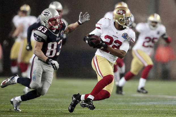 FILE - In this Dec. 16, 2012, file photo, San Francisco 49ers cornerback Carlos Rogers (22) runs back an interception of a pass that was intended for New England Patriots wide receiver Wes Welker (83) during NFL football game in Foxborough, Mass. Rogers, born in Augusta and an offseason resident of Atlanta, grew up doing the Dirty Bird dance when the Falcons reached the Super Bowl during the 1998 season. Rogers has paid for more than 30 tickets for friends and family as he makes an appearance in the Georgia Dome for only the third time in his eight-year career. The 49ers are scheduled to play the Atlanta Falcons in the NFC championship game Sunday. (AP Photo/Steven Senne, file)