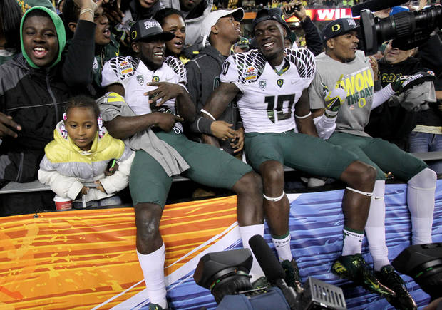 Oregon running back De'Anthony Thomas, left, and Rahsaan Vaughn (10) celebrate after the Fiesta Bowl NCAA college football game, Thursday, Jan. 3, 2013, in Glendale, Ariz. Oregon defeated Kansas State 35-17.(AP Photo/Paul Connors)