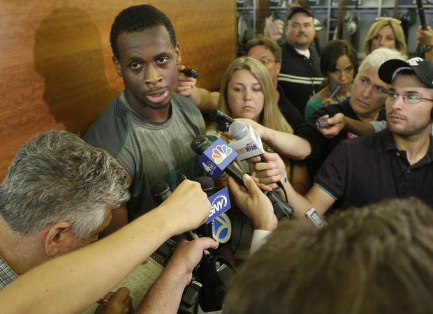 New York Jets quarterback Geno Smith talks to reporters after an NFL football practice in Florham Park, N.J., Monday, Aug. 19, 2013. (AP Photo/Seth Wenig)