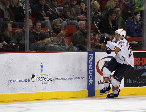 OKC's Chris VandeVelde (29) tries to gain control of a puck during a game between the Oklahoma City Barons and the Abbotsford Heat in Oklahoma City, Sunday, Jan. 15, 2012.  Photo by Garett Fisbeck, For The Oklahoman