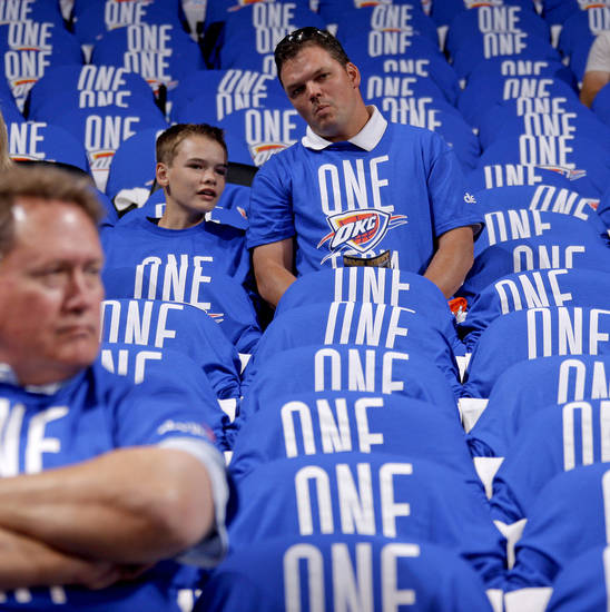 Chuck Curry and his son Clay Curry, 12, wait for the start of Game 1 in the second round of the NBA playoffs between the Oklahoma City Thunder and L.A. Lakers at Chesapeake Energy Arena in Oklahoma City, Monday, May 14, 2012. Photo by Bryan Terry, The Oklahoman