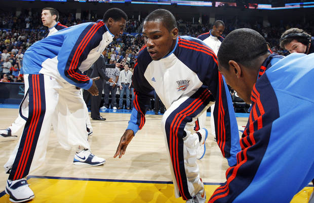 Oklahoma City's Kevin Durant slaps hands with Kyle Weaver, left, and Kevin Ollie during introductions before the NBA basketball game between the Los Angeles Lakers and the Oklahoma City Thunder at the Ford Center in Oklahoma City, Friday, March 26, 2010. Photo by Nate Billings, The Oklahoman