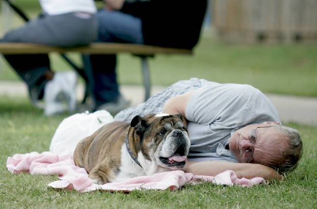 Ross Smith rests with his English bulldog, Chaco, at Lions Park in Norman during the Summer Breeze Concert Series on Sunday, July 13, 2008. By Amy Rymer, The Oklahoman