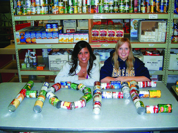 Randee Morales, left, and Joyclin Jaksons delivered cans of food to the Hope Center in Edmond on behalf of their academic honor society. Photo by Steve Gust, For The Oklahoman