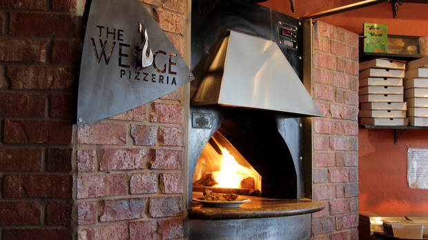 The Wedge Pizzeria, 4709 N Western, features pizzas baked in this wood-fired oven.  Photo by Dave Morris, NewsOK.com/The Oklahoman <strong>Dave Morris</strong>