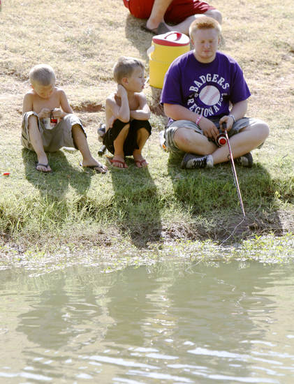 Karson Hetherington (left), Dylan Cole, and Triston Peters fish from the bank during a fishing derby at Little River Park in Moore, OK, Saturday, August 4, 2012,  By Paul Hellstern, The Oklahoman
