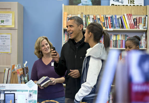 President Barack Obama, with daughters Sasha, far right, and Malia, center, goes shopping at a small bookstore, One More Page, in Arlington, Va., Saturday, Nov. 24, 2012. (AP Photo/J. Scott Applewhite)