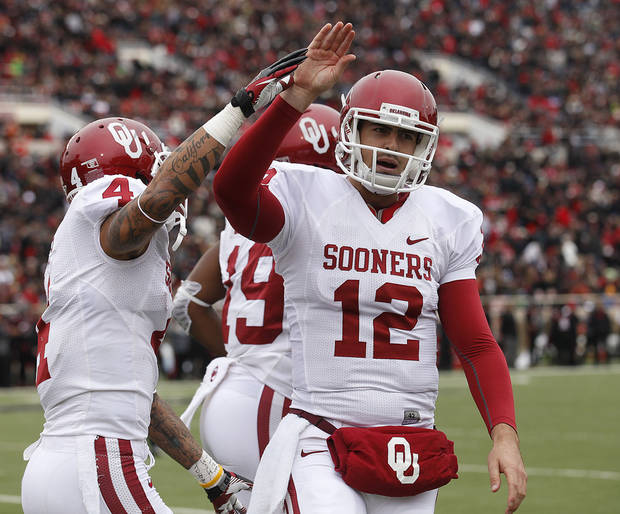 Oklahoma's Landry Jones (12) and Kenny Stills (4) celebrate after Oklahoma scored a touchdown against Texas Tech during an NCAA college football game in Lubbock, Texas, Saturday, Oct. 6, 2012. (AP Photo/Lubbock Avalanche-Journal, Stephen Spillman) LOCAL TV OUT