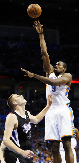 Oklahoma City's Serge Ibaka (9) shoots over Sacramento's Cole Aldrich (45) during an NBA basketball game between the Oklahoma City Thunder and the Sacramento Kings at Chesapeake Energy Arena in Oklahoma City, Monday, April 15, 2013. Photo by Nate Billings, The Oklahoman