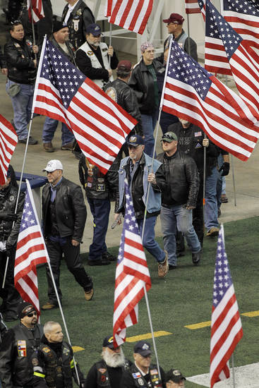 Patriot Guard Riders line the sidelines of the field during a memorial service for Christopher Kyle at Cowboys Stadium, Monday, Feb. 11, 2013, in Arlington, Texas. Thousands attended the public memorial service for Kyle, the former Navy SEAL sniper who was shot to death at a Texas shooting range. (AP Photo/Brandon Wade)