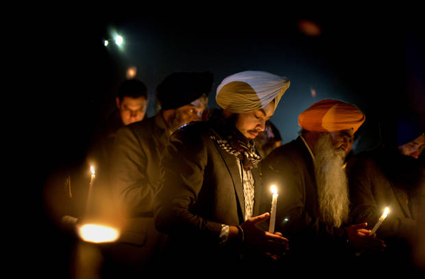 Varinder Singh, of the Queens borough of New York, joins a group of Sikhs from around the Northeastern U.S., in a moment of prayer as a memorial service is broadcast over a loudspeaker outside Newtown High School for the victims of the Sandy Hook Elementary School shooting, Sunday, Dec. 16, 2012, in Newtown, Conn. (AP Photo/David Goldman) ORG XMIT: CTDG136