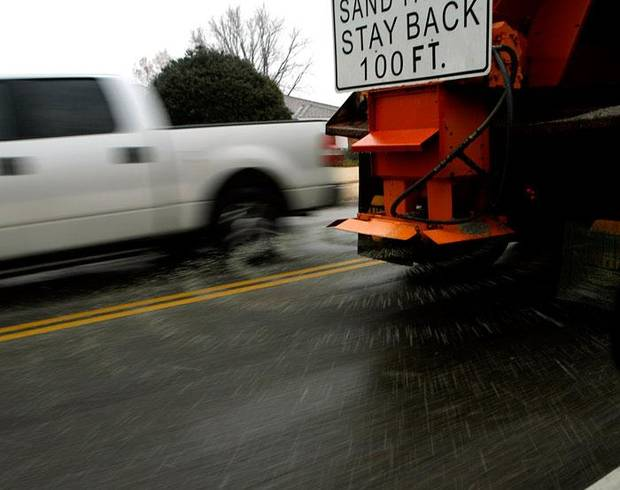 A truck from the City of Edmond drops sand on 33rd street east of Boulevard during winter weather in Edmond, Okla., on Monday, Jan. 26, 2009. BY JOHN CLANTON, THE OKLAHOMAN