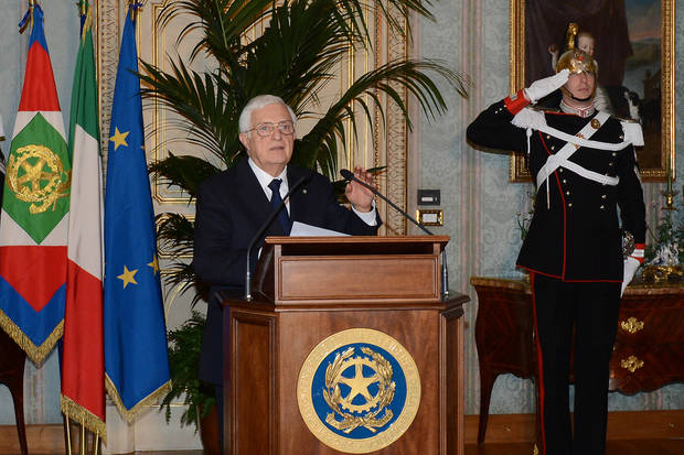 In this photo released by the Italian Presidency, the general secretary Donato Marra officially announces the resignation of Mario Monti at the Quirinale presidential palace in Rome Friday, Dec. 21, 2012. Mario Monti handed in his resignation to Italy&#039;s president in Rome on Friday, bringing to a close his 13-month technical government and preparing the country for national elections. President Giorgio Napolitano -- who tapped Monti in November 2011 to come up with reforms to shield Italy from the continent&#039;s debt crisis -- asked Monti to stay on as head of a caretaker government until the national vote, expected in February. (AP Photo/Antonio Di Gennaro, Italian Presidency ho)
