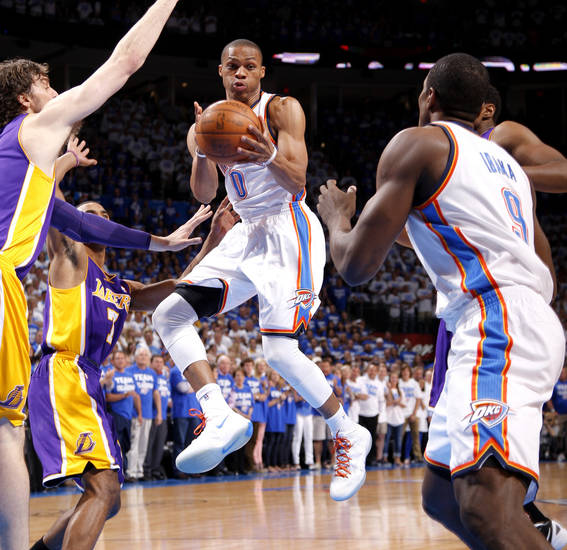Oklahoma City's Russell Westbrook (0) looks to pass during Game 2 in the second round of the NBA playoffs between the Oklahoma City Thunder and L.A. Lakers at Chesapeake Energy Arena in Oklahoma City, Wednesday, May 16, 2012. Photo by Bryan Terry, The Oklahoman