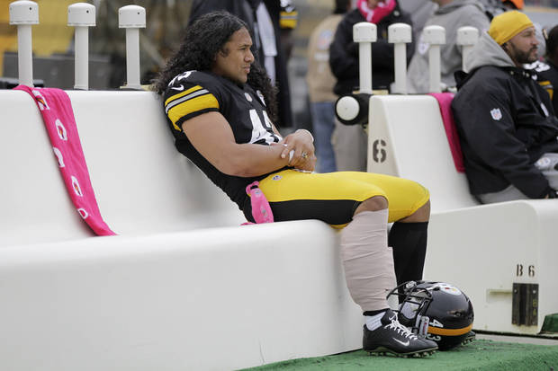 Pittsburgh Steelers strong safety Troy Polamalu (43) sits on the bench after getting his leg wrapped in the second quarter of an NFL football game against the Philadelphia Eagles in Pittsburgh, Sunday, Oct. 7, 2012. (AP Photo/Gene J. Puskar)