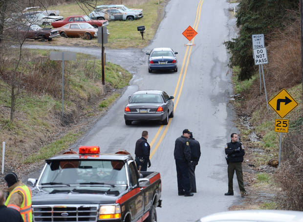 Local law enforcement block off road along Rt. 22 near the Canoe Creek State Park, Pa. while investigating a shooting on Friday, Dec. 21, 2012.   The suspect fired at troopers responding to Friday morning&#039;s shootings in Frankstown Township, about 70 miles west of Harrisburg. The fleeing gunman then crashed head-on into a trooper&#039;s car and got out of his truck and shot again at police, who returned fire and killed him. Blair County District Rich Consiglio says the gunman killed two men and one woman. (AP Photo/Altoona Mirror,  J.D. Cavrich)