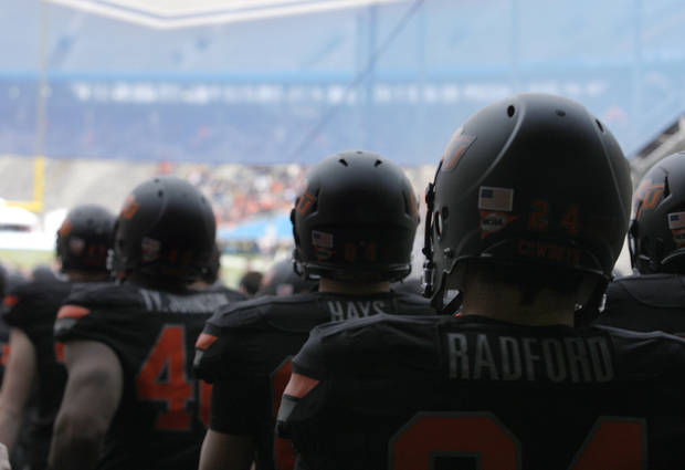 OSU walks to the field before the Heart of Dallas Bowl football game between the Oklahoma State University (OSU) and Purdue University at the Cotton Bowl in Dallas,  Tuesday,Jan. 1, 2013. Photo by Sarah Phipps, The Oklahoman