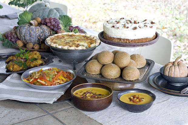 A vegetarian Thanksgiving dinner of red bell pepper and apple slaw, no knead flax rolls, roasted vegetable quiche, lemon pecan mousse cake, corn bread stuffing mushrooms and squash bisque with pan roasted corn salsa is shown served on a table in Concord, N.H. AP PHOTO <strong>Matthew Mead - AP</strong>