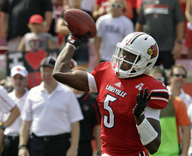 Louisville quarterback Teddy Bridgewater (5) launches a pass during the first quarter of an NCAA college football game against Ohio University in Louisville, Ky., Sunday, Sept. 1, 2013. (AP Photo/Garry Jones)