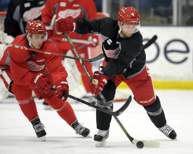 Detroit Red Wings' Valtteri Filppula, left, tries to get the puck away from Jakub Kind during the NHL hockey team's training camp Sunday, Jan. 13, 2013, in Plymouth, Mich. (AP Photo/The Detroit News, David Guralnick) DETROIT FREE PRESS OUT  HUFFINGTON POST OUT  MAGS OUT