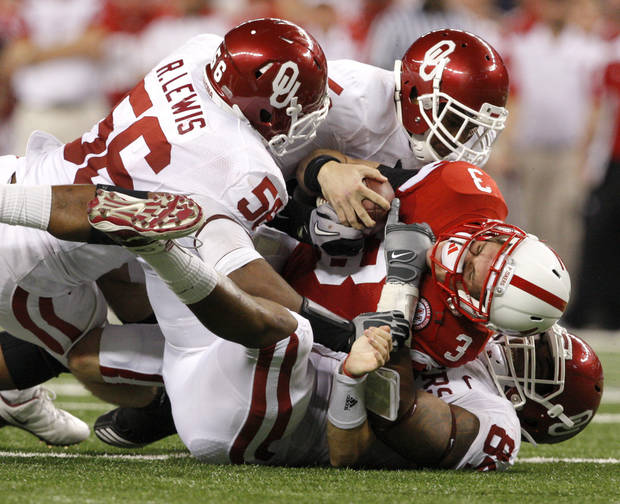 OU's Ronnell Lewis, left, Joseph Ibiloye, and Frank Alexander bring down Nebraska's Taylor Martinez during the Big 12 football championship game between the University of Oklahoma Sooners (OU) and the University of Nebraska Cornhuskers (NU) at Cowboys Stadium on Saturday, Dec. 4, 2010, in Arlington, Texas.  Photo by Bryan Terry, The Oklahoman